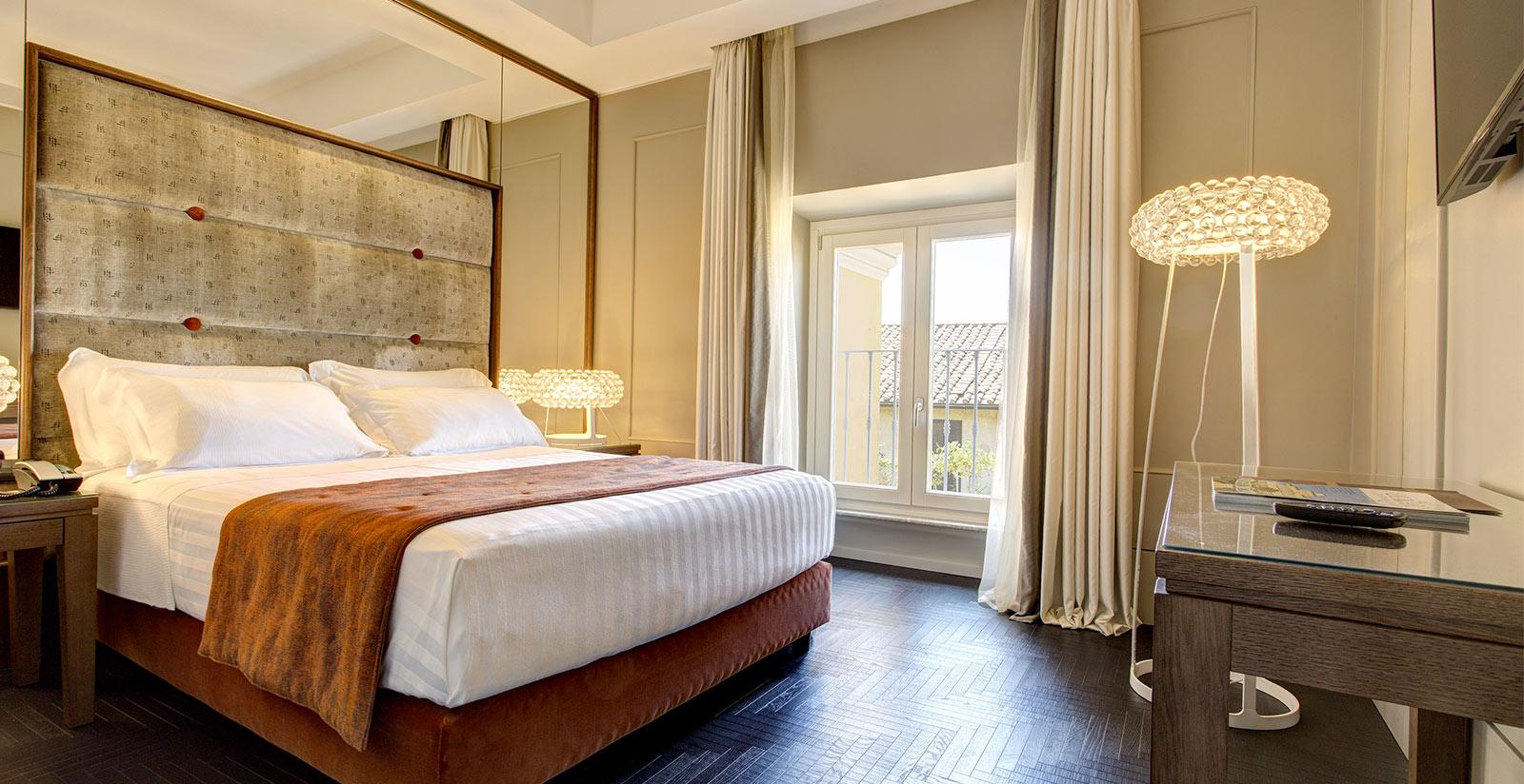 Le camere del Mascagni Luxury Dependance sono moderne e ...